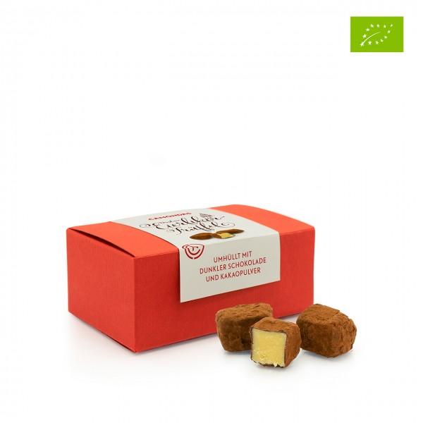 CAMONDAS - Eierlikörtrüffel umhüllt mit dunkler Schokolade und Kakaopulver